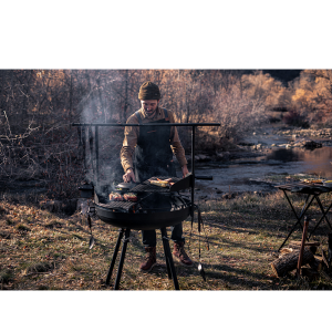 Barebones Cowbow Firepit Grill System in use